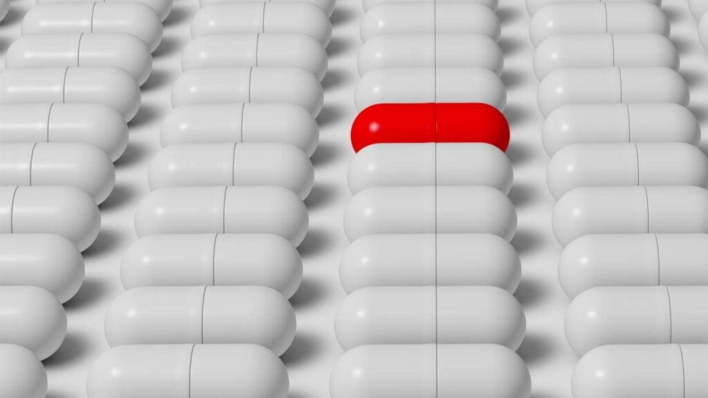 Rött piller som sticker ut i mängden.